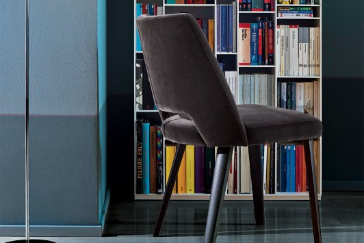 In this picture: Grace chair with lacquered oak wood frame, absolute black colour and upholstered with Fiocco velvet, glacé brown colour.
